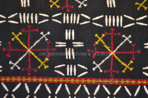 Detail of seed bead embroidery on woman's blouse Karen tribe Thailand