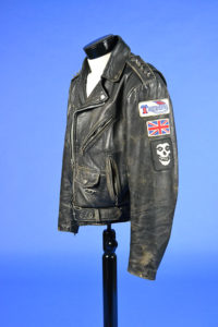leather motorcycle jacket with arm patches of Union Jack flag and skull
